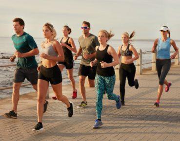 photodune-o2hZEme2-young-people-running-along-beach-boardwalk-xxl
