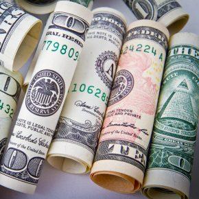 US dollars rolled bills square